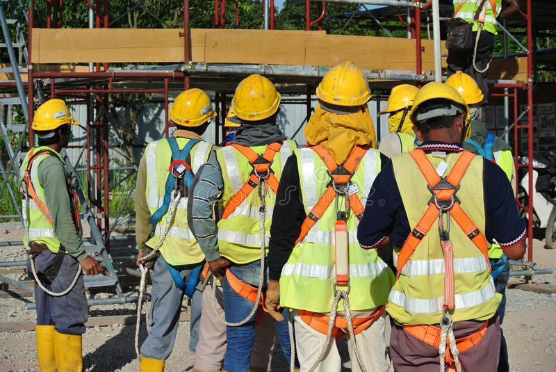 Group of construction workers assemble at the open space. royalty free stock image