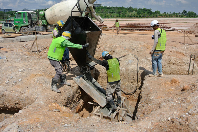 Group of construction workers casting pile cap royalty free stock images