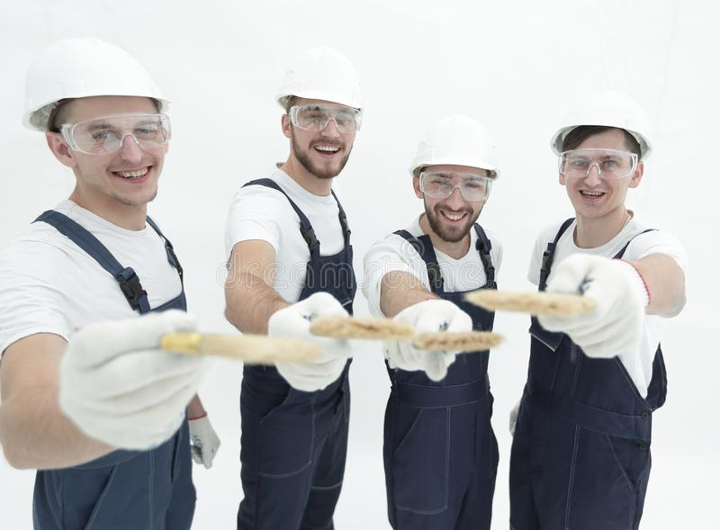 Group of construction workers .isolated on white stock photos