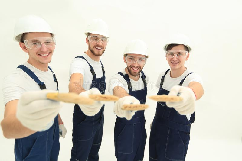 Group of construction workers .isolated on white stock images