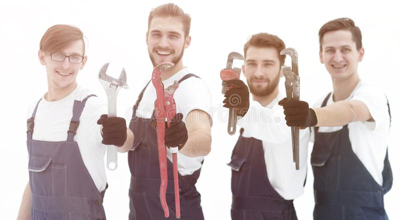 Group of construction workers with working tools stock photography
