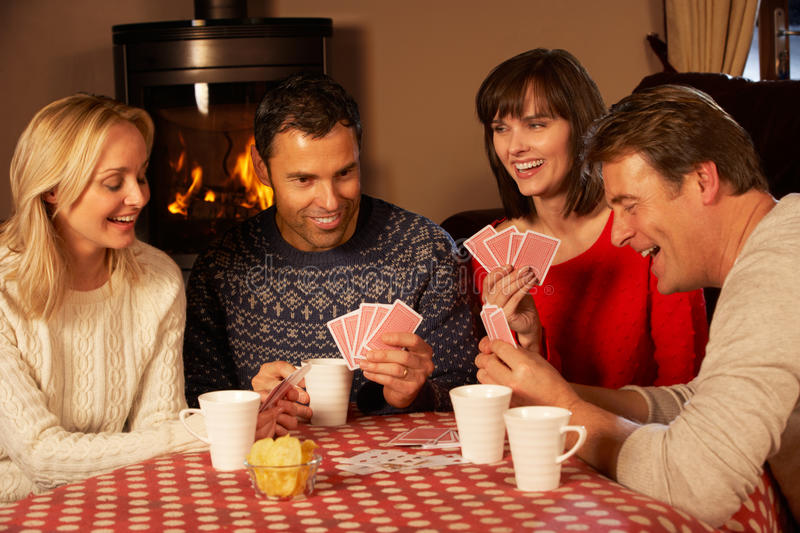 Download Group Of Couples Playing Cards Together Royalty Free Stock Photography - Image: 25642547
