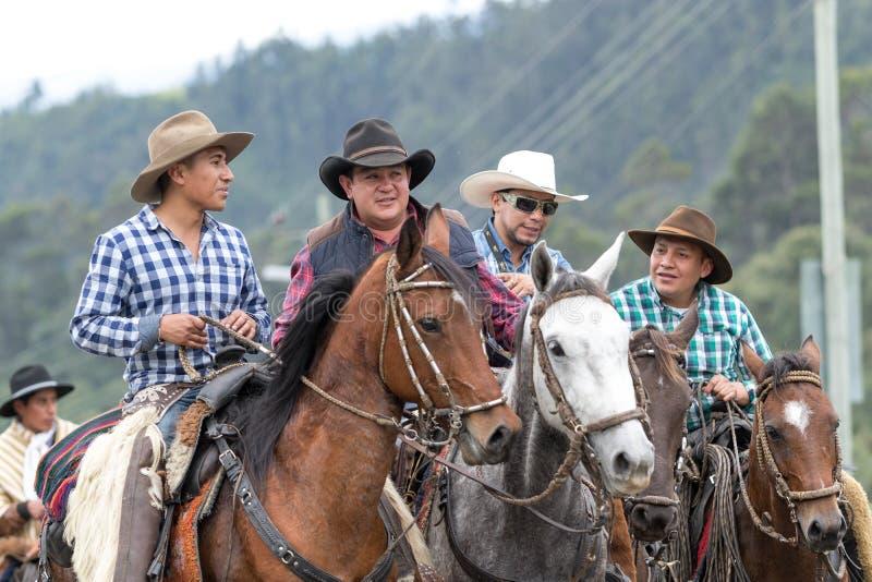 Group of cowboys riding their horses in Ecuador royalty free stock image
