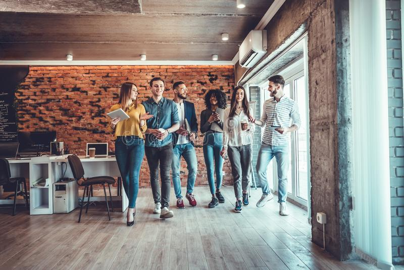 Group of creative business team standing together and laughing. Multiracial business people together at startup stock photo