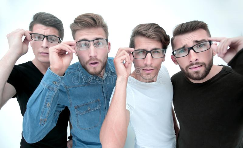 Group of creative young men looking at you through glasses royalty free stock image