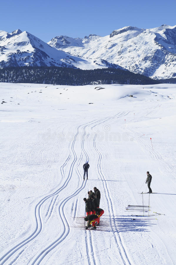 Group of crosscountry skiers resting. In Aran Valley from spanish Pyrenees royalty free stock photo