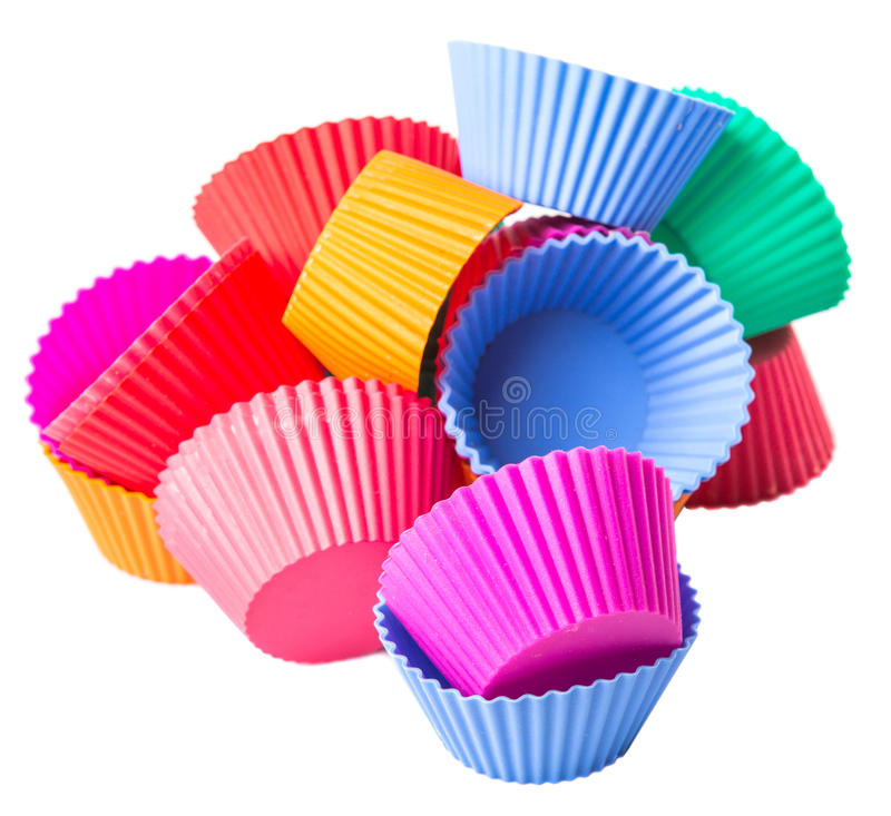 A Group Of Cupcake Silicone Baking Cups III. Various color cupcake silicone baking cups over white background royalty free stock photography