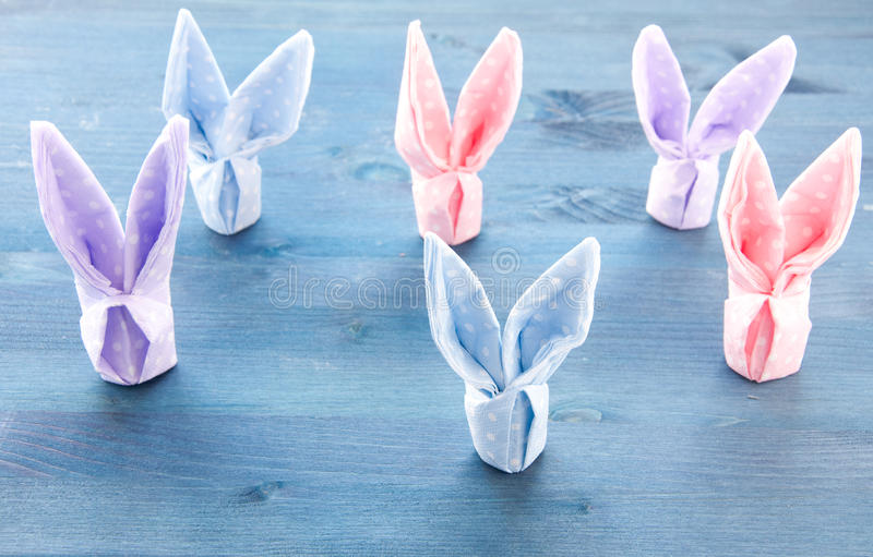 Group of Cute bunnies colorful paper red stock image