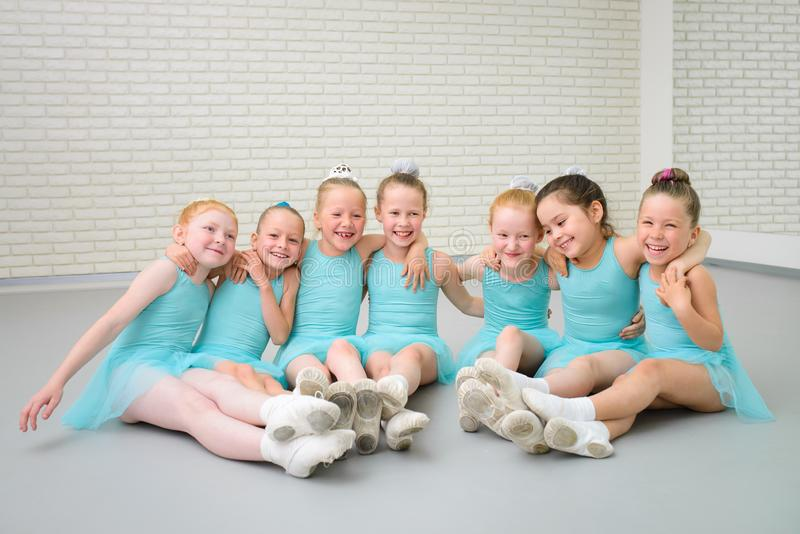 Group of cute little ballet dancers having fun at dance school class. Group of cute little ballet dancers having fun at dance school class stock images