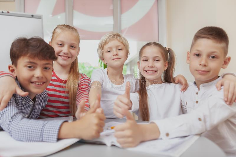 Group of cute little kids drawing together in art class stock photography