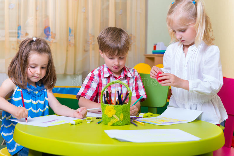 Group of cute little prescool kids playing royalty free stock photo