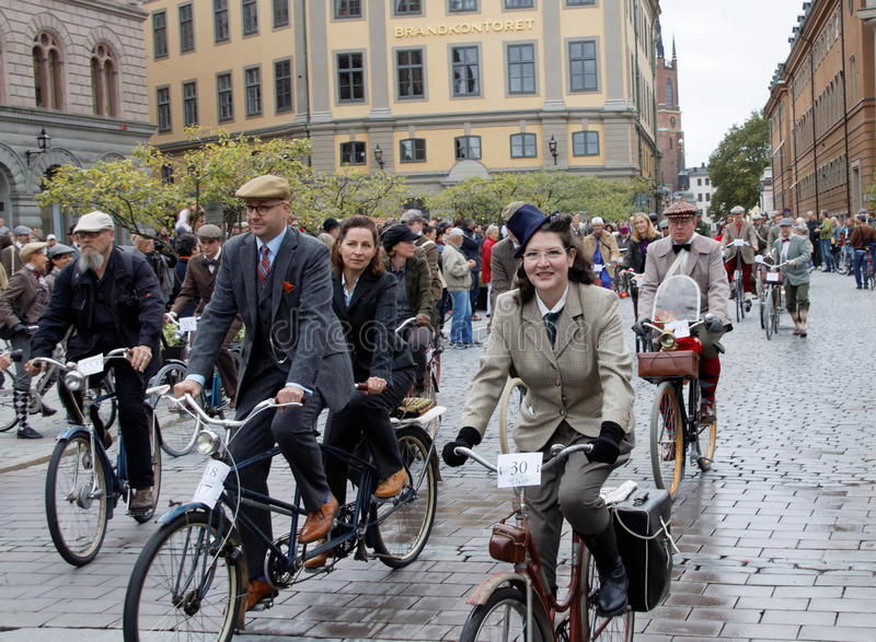 Group of cycling people wearing old fashioned tweed clothes stock photo