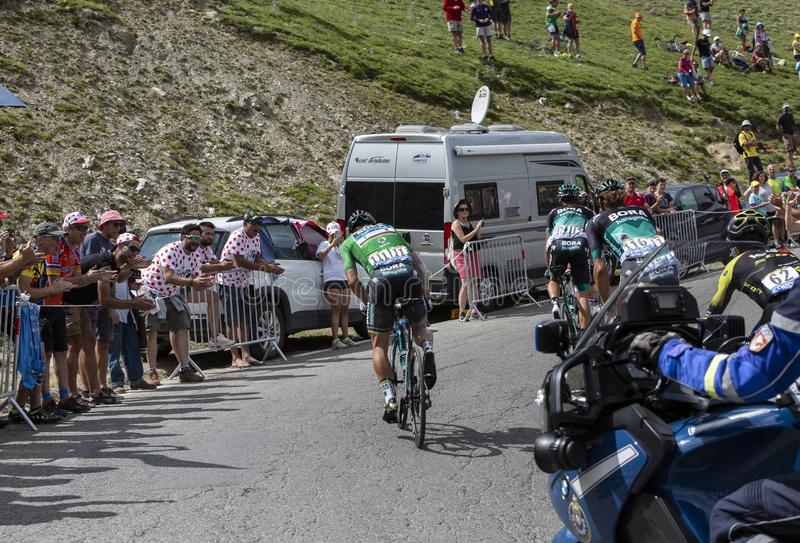 Group of Cyclists on Col du Tourmalet - Tour de France 2018. Col du Tourmalet,France-July 27,2018: Rear view of a group of cyclists including Peter Sagan in royalty free stock photography