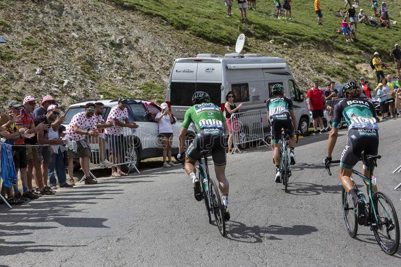 Group of Cyclists on Col du Tourmalet - Tour de France 2018. Col du Tourmalet,France-July 27,2018: Rear view of a group of cyclists including Peter Sagan in stock photos
