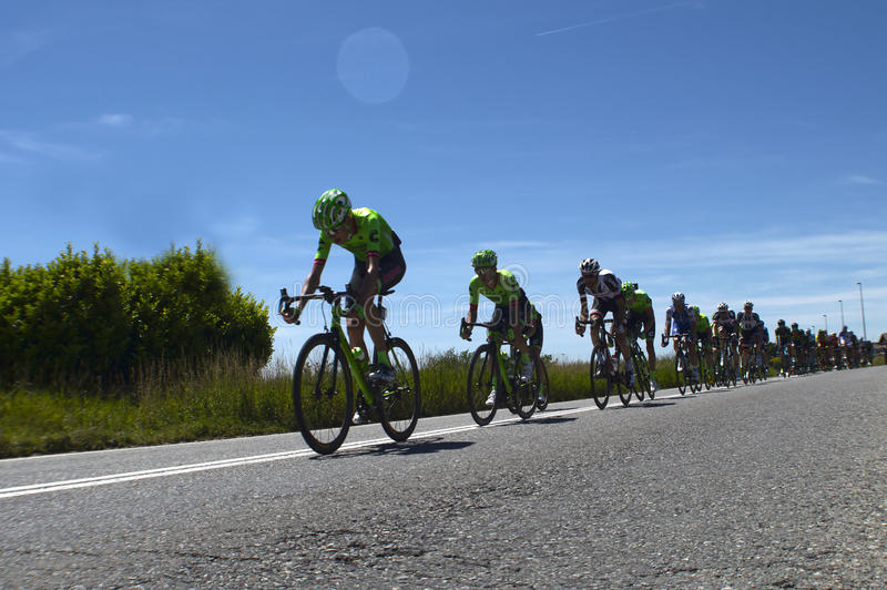 Group of cyclists at italy bike tours. On asphalt stock photo
