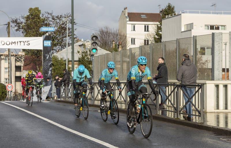 Group of Cyclists from Team Astana - Paris-Nice 2018 stock photo