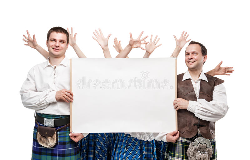 Group of dancers of Scottish dance with empty banner stock photo