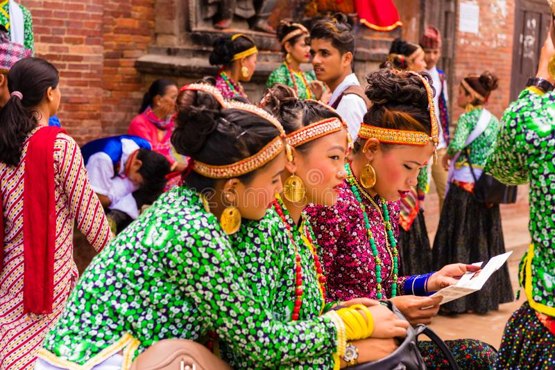 Group of dancers wearing traditional costumes in Patan Durbar Square, Kathmandu Valley, Nepal stock image
