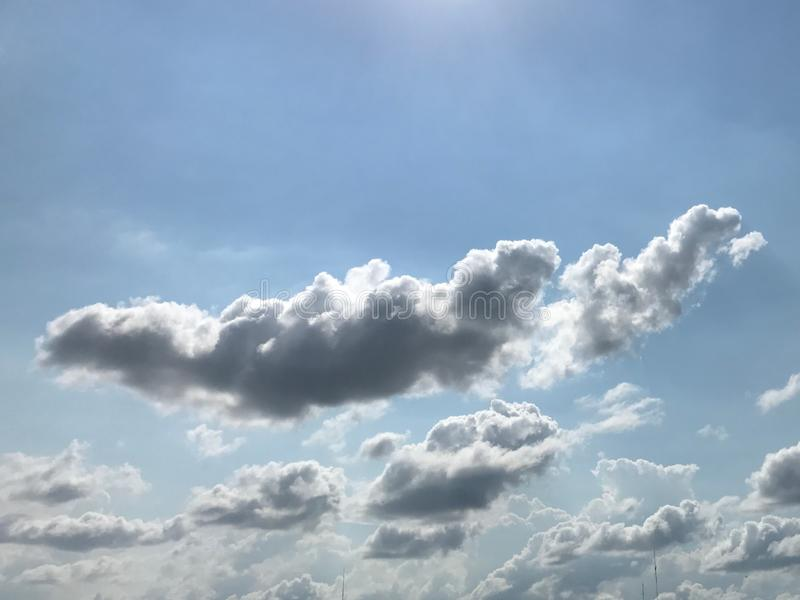 A group of dark grey clouds on a very cloudy sky stock photo