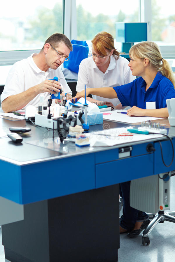 Group in dental lab stock photos