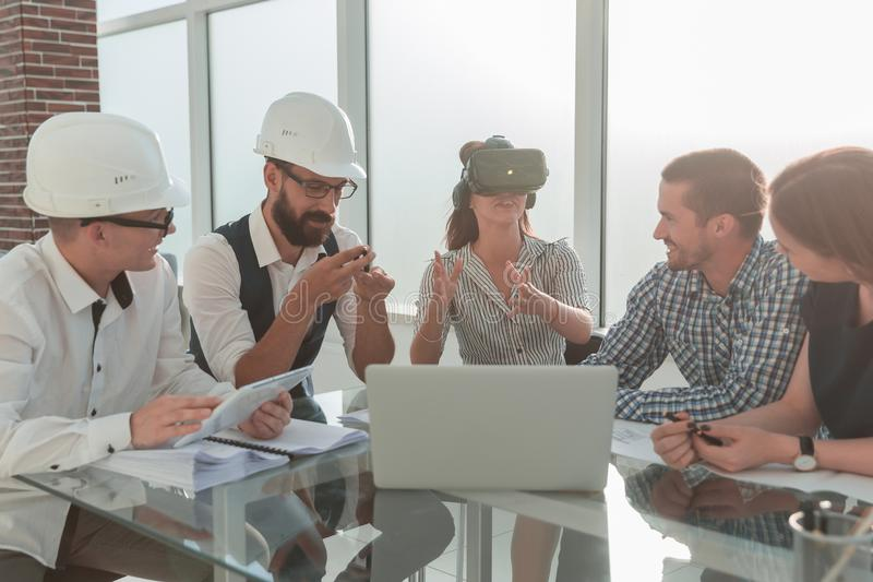 Group of designers and architects discussing a new project royalty free stock photo