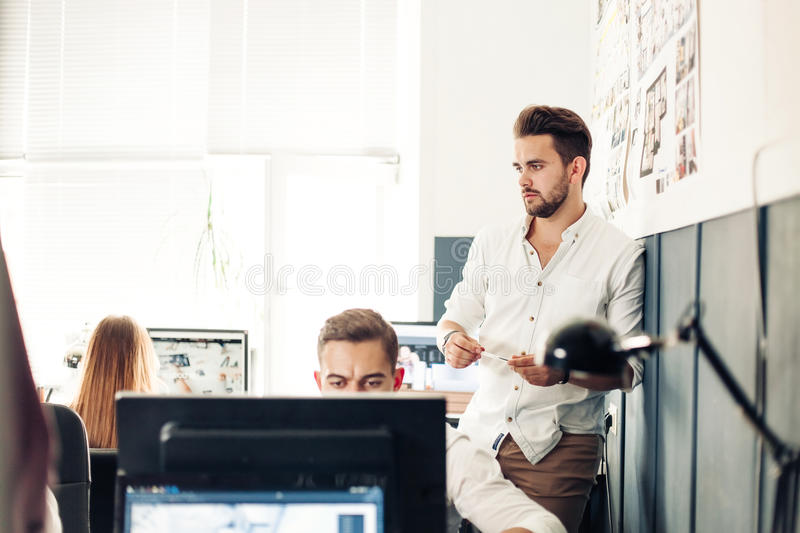 Group designers and architects Meeting In Office royalty free stock images
