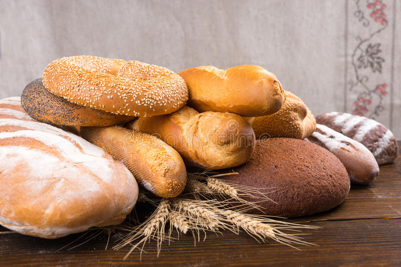 Group of different breads in pile stock photo