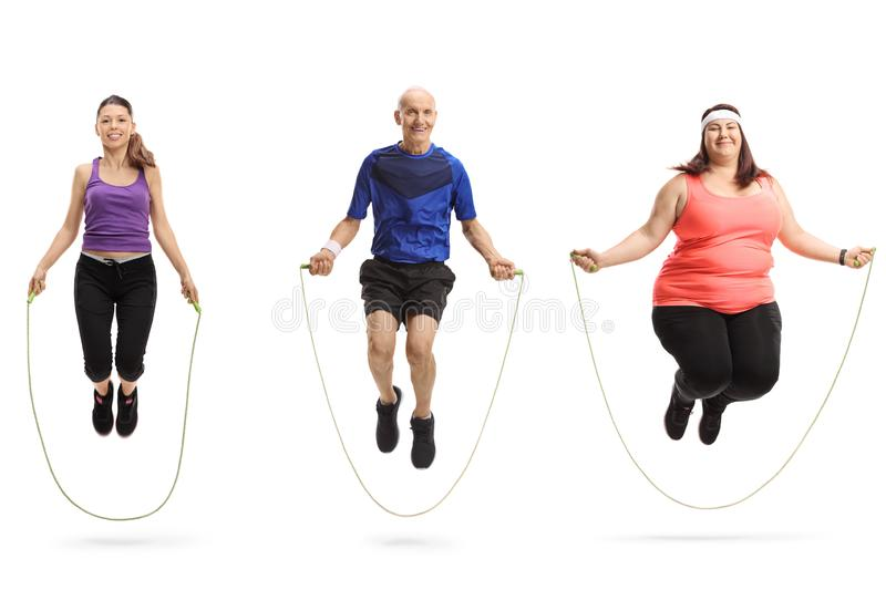 Group of different people jumping with a skipping rope. Full length portrait of a group of different people jumping with a skipping rope isolated on white royalty free stock images