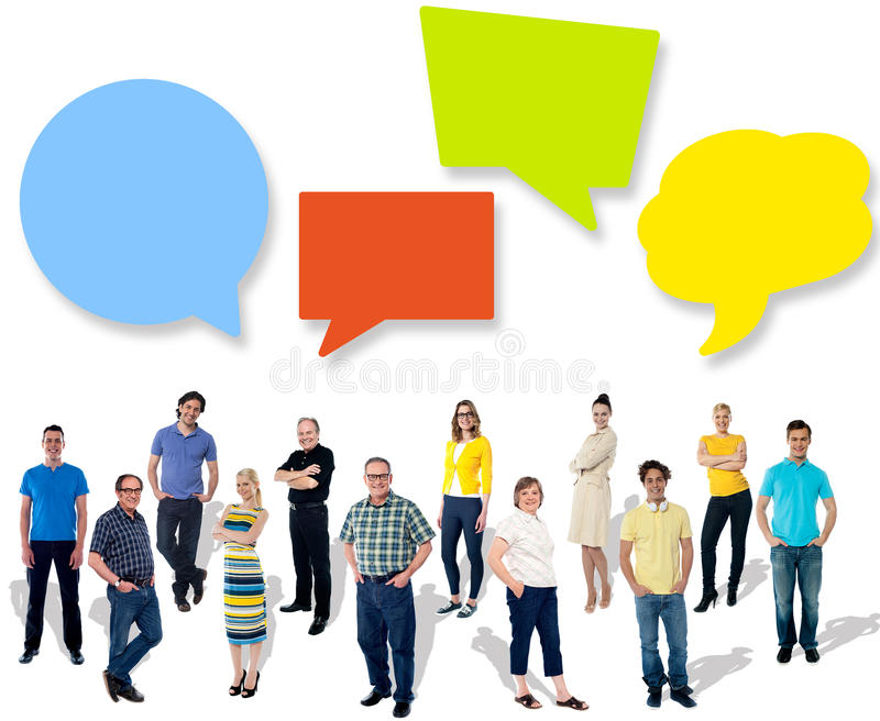 Group of different people sharing ideas. Diverse people posing with speech bubbles royalty free stock photography