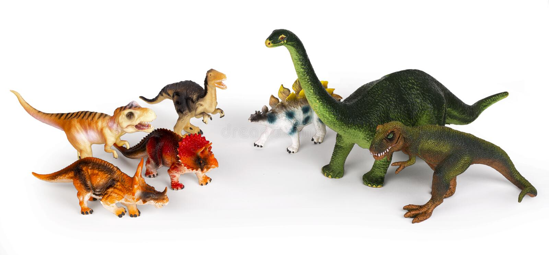 Group of dinosaurus plastic toy models royalty free stock photo