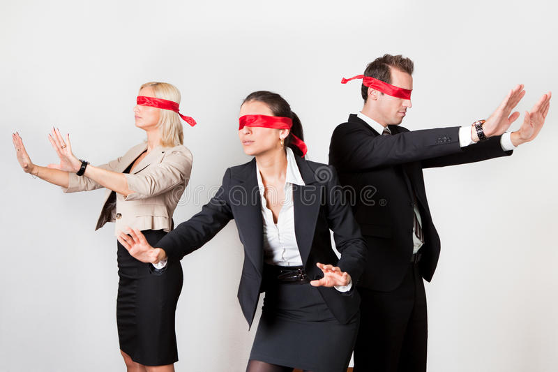 Group of disoriented businesspeople royalty free stock photography