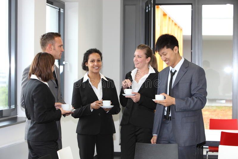 Group of diverse businesspeople on coffee break royalty free stock photography
