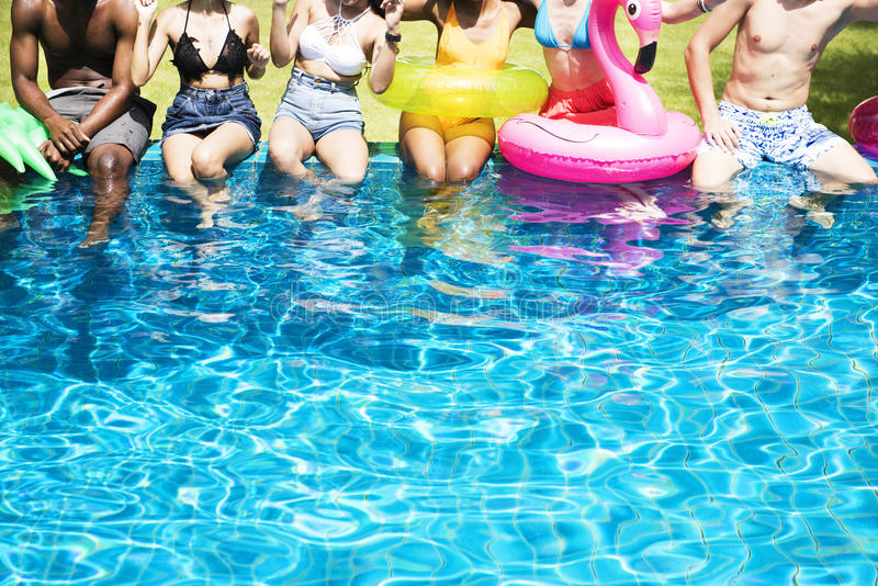 Group of diverse friends enjoying summer time by the pool with i stock photos