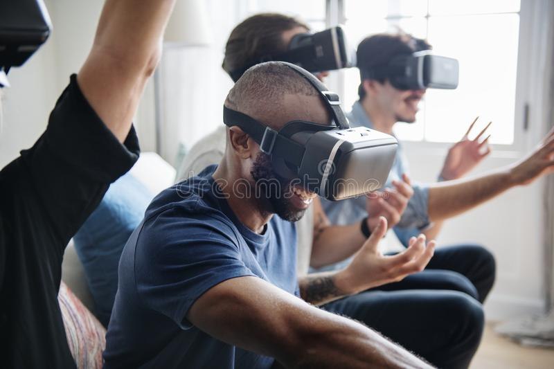 Group of diverse friends experiencing virtual reality with VR hea stock photos