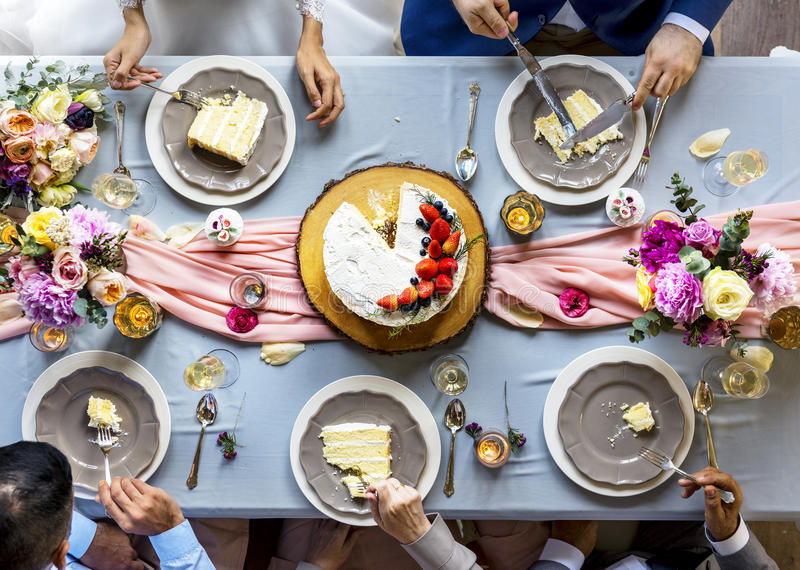 Group of Diverse Friends Gathering Eating Cakes Together stock photos