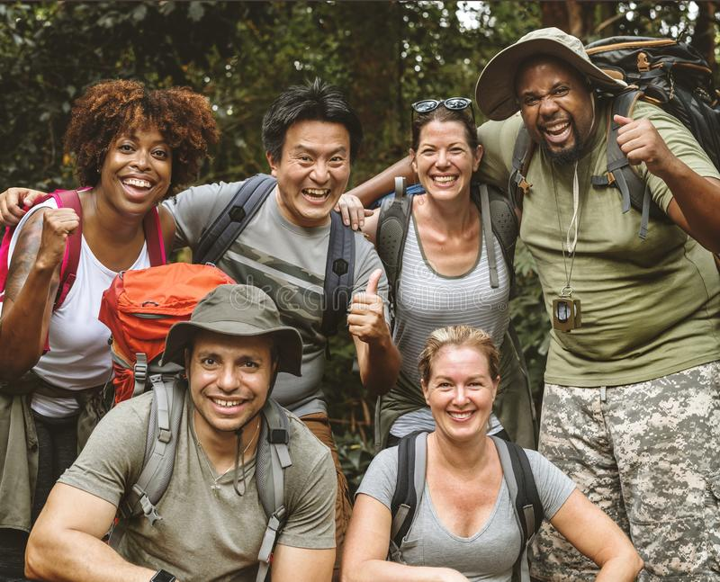 Group of diverse friends trekking together stock photography