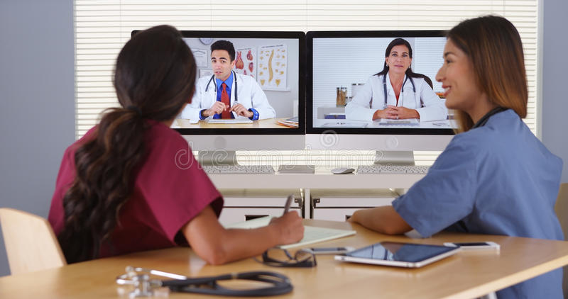 Group of diverse medical doctors video conferencing stock photography