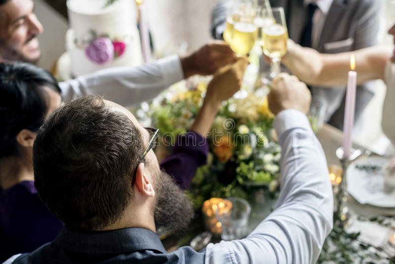 Group of Diverse People Clinking Wine Glasses Together Congratulations Celebration royalty free stock images