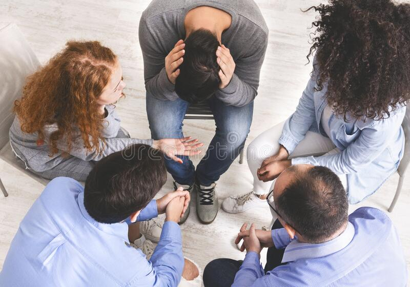Group of diverse people discussing their problems in trust circle stock image