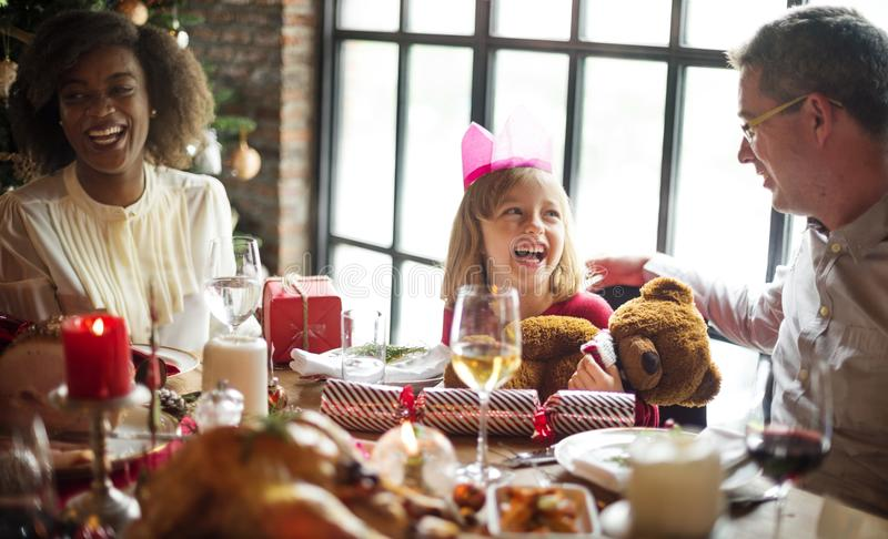 Group of diverse people are gathering for christmas holiday stock photography