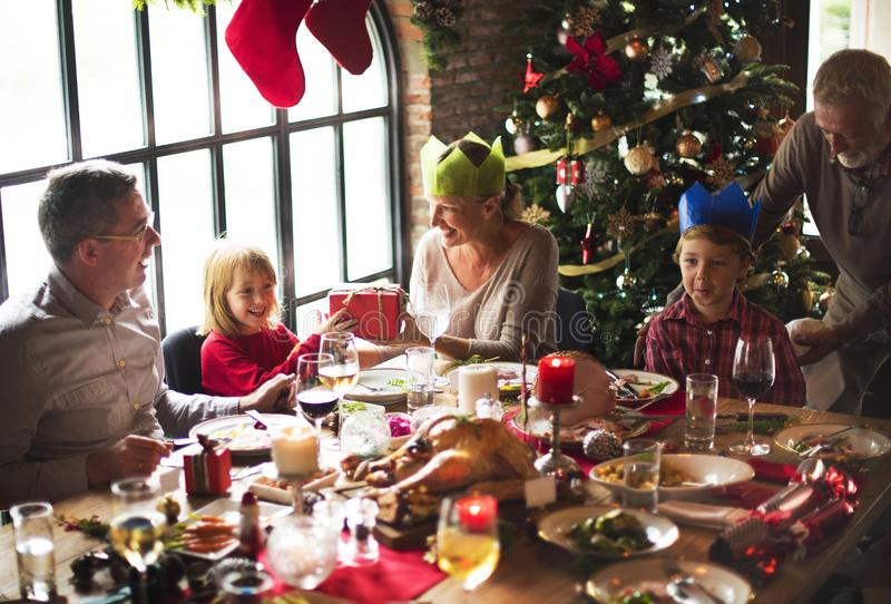 Group of diverse people are gathering for christmas holiday royalty free stock photo