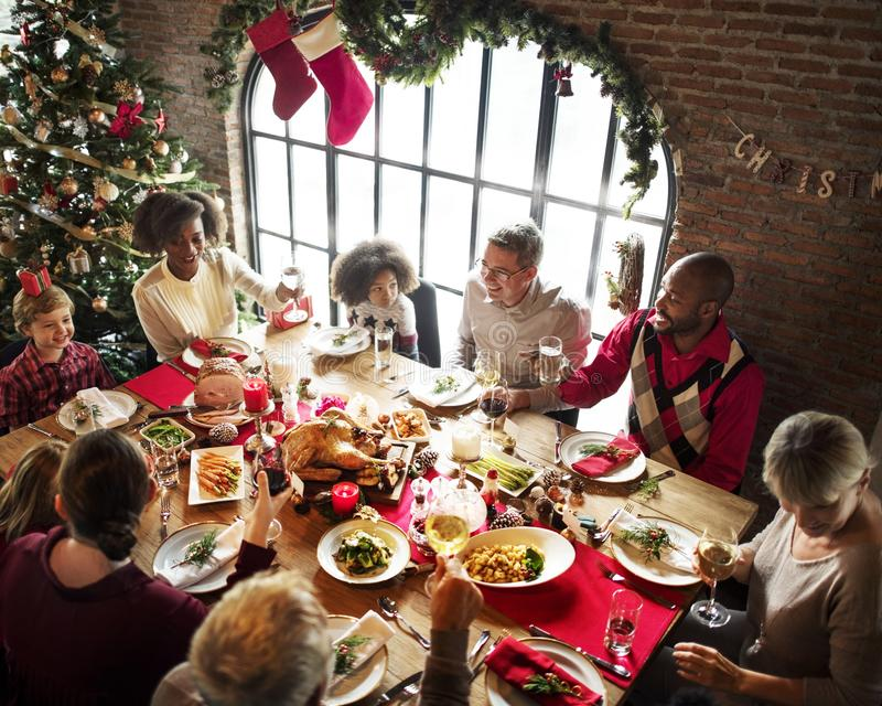 Group of diverse people are gathering for christmas holiday royalty free stock photography