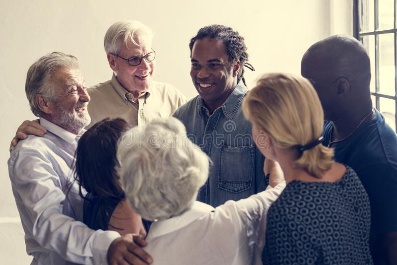 Group of diverse people giving each other support stock image