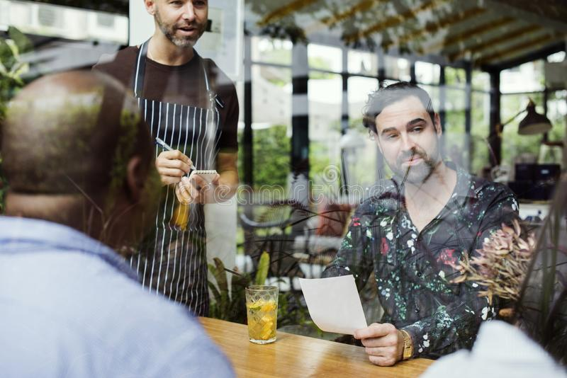 Group of diverse people in the restaurant royalty free stock image