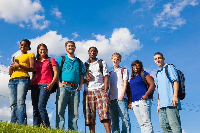 Group of diverse students/friends outside royalty free stock photos