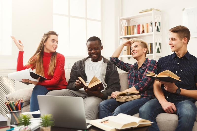 Group of diverse students studying at home atmosphere on the cou stock images