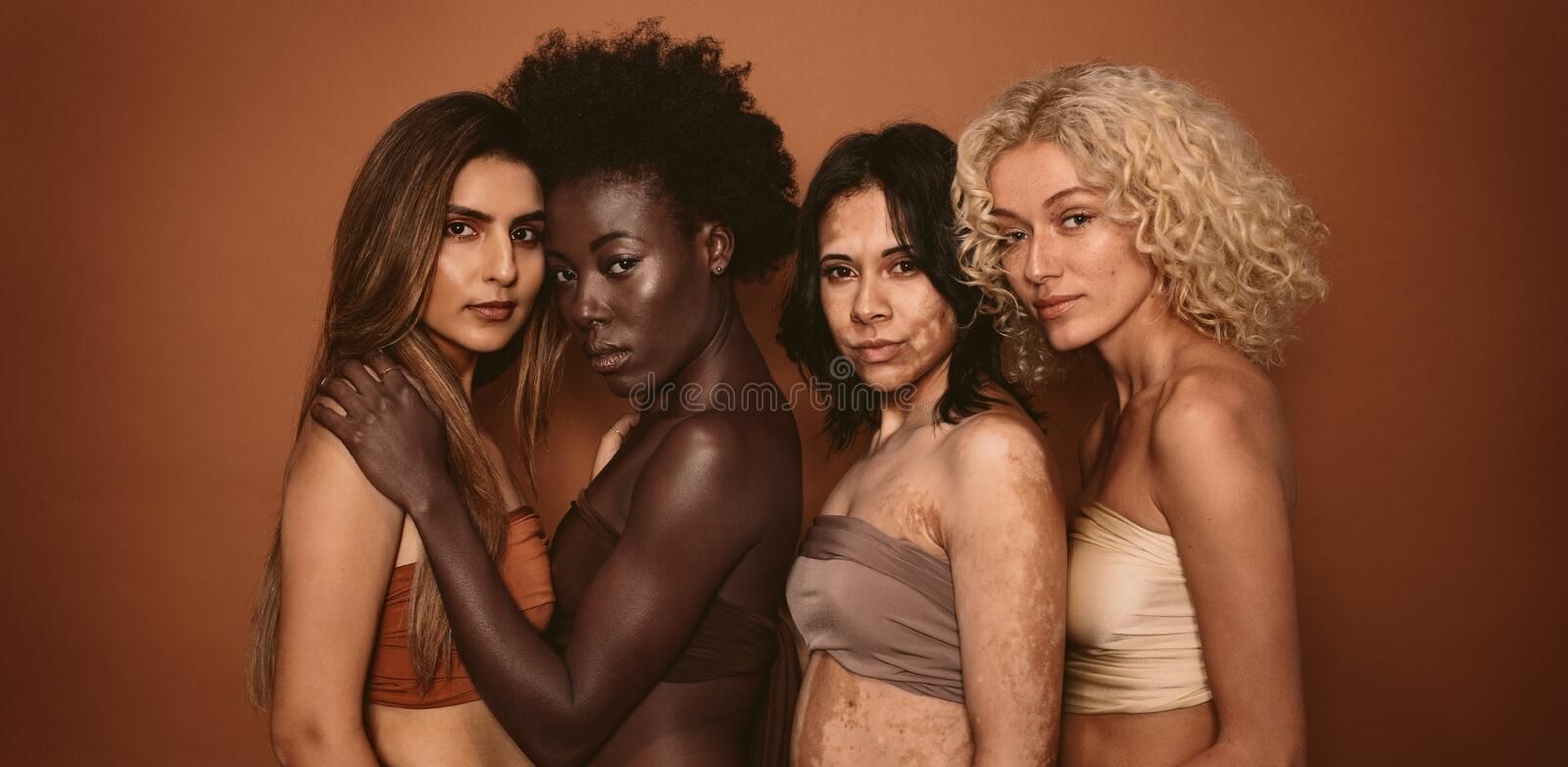Group of diverse women standing together royalty free stock photos