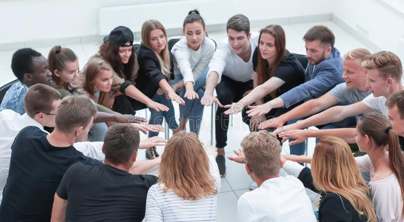 Group of diverse young people joining their palms together royalty free stock photography