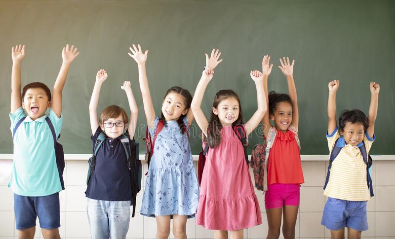 Diverse young students standing together in classroom royalty free stock images