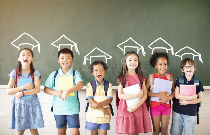 Diverse young students standing together in classroom royalty free stock image
